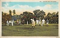 PLAYING GOLF IN FLORIDA-PERIOD GOLFING ATTIRE-SPORTS POSTCARD 1920s