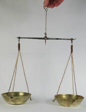 A set of 18th century hand held equal arm pan balance scales. Maker IB