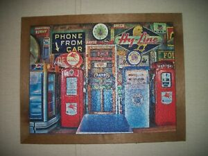 man cave framed puzzle of garage and old gas pumps and signs