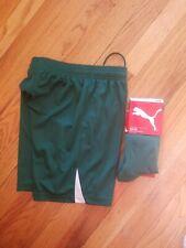 Boys Green Puma team socks long size 3.5-6 and a Youth Medium Green Puma Shorts.