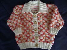 babys hand knitted cardigan in snowball and tropics