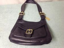 Coach leather size medium, Black pre-owned purse. The purse is genuine.