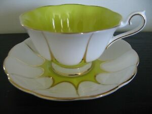 ROYAL ALBERT YELLOW WIDE MOUTH TEA CUP AND SAUCER