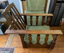 More details for a pair of vintage arts and crafts style adjustable oak lounge chairs.