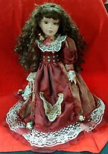 PORCELAIN DOLL IN DEEP RED TONED SATIN DRESS
