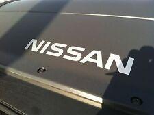 "NEW OEM 2005-2014 XTERRA ROOF RACK - AIR DAM DECAL / EMBLEM ""NISSAN"""