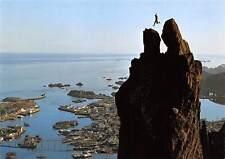 Norway Mountain climber jumping at the Mount Svolvaergeita