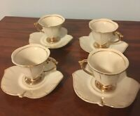 4 Tulip shaped porcelain demitasse cups and saucers