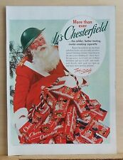 1942 magazine ad for Chesterfield - Santa in army helmet with sack of cigarettes