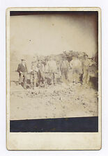 CABINET CARD PHOTO SHOWING SEVEN MINERS WITH RIFLE, PICKAXE & FOUR SHOVELS