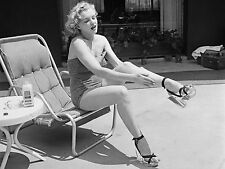 Marylin Monroe Putting Nivea lotion to her legs 1951 8 x 10 photograph