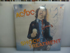 AC/DC-SHOCK TREATMENT. COLUMBUS, OH, USA 1978.-ORANGE VINYL LP-NEW.SEALED.