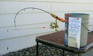 (2) Ice fishing pole automatic hook setters. Fishing tackle for ice fishing rods
