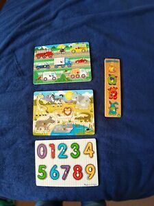 3 Melissa and doug wooden puzzles.  Plus Extra ELC animal Puzzle.