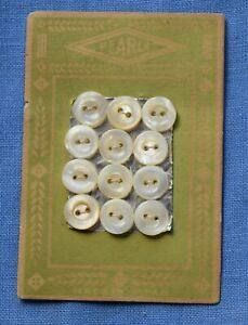 """0057  Antique """"Pearls"""" mother of pearl shell button card, feather & line graphic"""