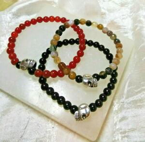 Set Of 3 Natural Stone Bracelets Black Onyx Carnelian Brown Onyx Skull Crystal