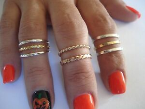 14 K & 10 K. SOLID GOLD OVER THE KNUCKLE BAND OR THUMB RING HAND MADE IN U.S.