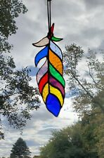 Stained glass feather Sun catcher 8 1/4 inches long.               Free shipping