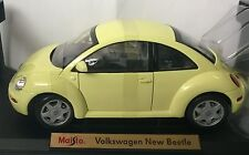 MAISTO 1:18 AUTO IN METALLO VOLKSWAGEN NEW BEETLE GIALLA ART 31875
