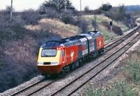PHOTO  CLASS 43 HST IN VIRGIN LIVERY AT  HAWKERIDGE 1980'S