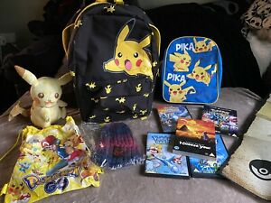 LARGE POKEMON BUNDLE~2 PIKACHU BACKPACKS XL POSTER , METALLIC POSTER,DVDS,TOY
