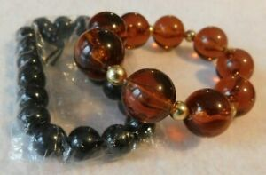 Lot of 2 Stretch Bracelets Black Stone ? & Amber Clr. Lucite Beads Gold Tn Space