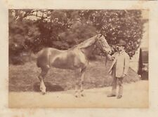 Mounted photograph of a man with a horse