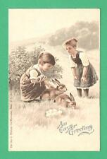 EARLY WHITNEY EASTER POSTCARD YOUNG GIRLS DOLL BUNNIES EGGS FIELD