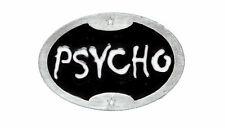 Psycho, Gürtelschnalle
