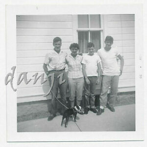family posed by house with BOSTON TERRIER Dog on a leash looking back*1959 Photo