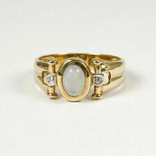Elegante Anillo Oro Amarillo 585 , con Auténtico Aguamarina y Dos Diamantes