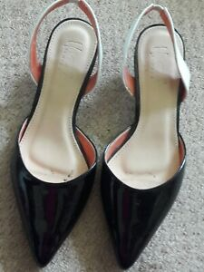 Black and white slingbacks with kittens heels 1.5 inches size 3