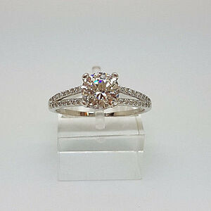 Stunning 9ct White Gold Solitaire With Accents Ring.  Goldmine Jewellers.