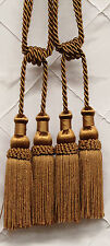A pair of Beautifully Made Tie back Mini Double Tassel in Coffee color