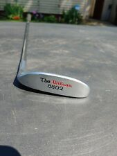 Right hand  The Wilson 8802 putter---all original with headspeed band