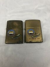 Two Solid Brass Zippos. Painted With U.S.S. Coral Sea CV-43. Used.