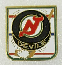 circa 1990 NEW JERSEY DEVILS Hockey PUCK logo tie tack lapel pin