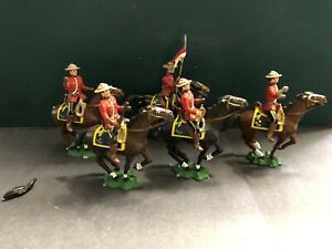 RCMPs On Galloping Horses.  54mm metal models