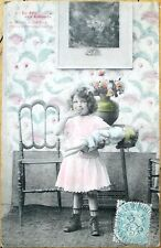 1905 French Doll Postcard: Little Girl w/Doll Covering her Mouth