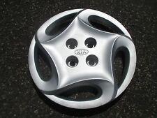 one 1998 to 2001 Kia Sephia 14 inch bolt on hubcap wheel cover