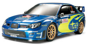 Tamiya TT02 1/10 4WD Touring with Subaru Impreza WRC 2007 Monte Carlo Body
