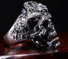 anello con teschio in acciaio