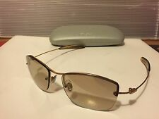 New DKNY 7255S (715) Sunglasses, Gold / Bronze with Lite Black Mirror Lens
