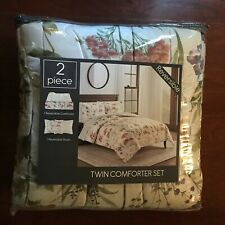 Lila reversible comforter set. Floral-print pattern; reverses to solid.