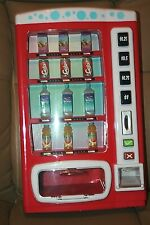 TOY SODA MACHINE TAKES PLAY MONEY AND SODA CANS & BOTTLES come out
