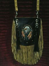 This is a beautiful hand crafted purse it is black and tan.