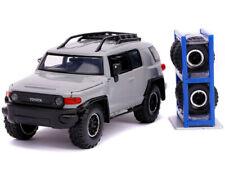 Jada 31557 Just Trucks Toyota FJ Cruiser / Roof Rack 1:24 with Extra Wheels Grey