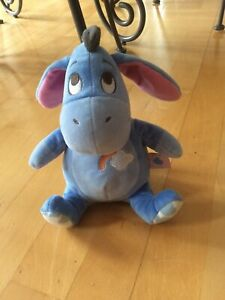 """Disney Eeyore Baby Soft Toy With Rattle Inside Approx 8"""" Rainbow/ Cloud Motif"""