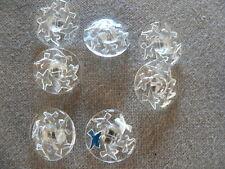 7 anciens boutons en verre transparent à décor d'oiseau