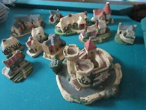 ROYAL DOULTON HAND CRAFTED VILLAGE WITH 12 BUILDING LARGEST 5 X 7, SMALLEST2 1/2